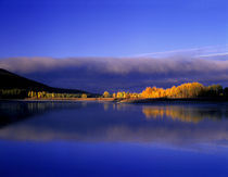 Fall colors and storm clouds at Oxbow Bend on Snake River by Danita Delimont
