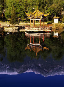 Cangshan Mountains and park pavilion reflect in small lake by Danita Delimont