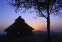 Sunset over a traditional Konso hut by Danita Delimont