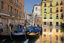 Gondolas moored along canal von Danita Delimont