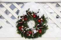 Christmas wreath on fence by Danita Delimont