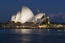 Opera House at night on waterfront by Danita Delimont
