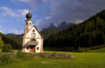 Beautiful isolated lonely church called Rainui in valley in the Italian Dolomites village of Val Di Funes mountains Alpine area of Italy with Dolomites looming behind by Danita Delimont
