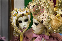 Woman dressed in costume for the annual Carnival festival looks in mirror by Danita Delimont