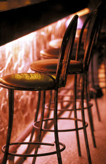 Barstools in pink light von Danita Delimont