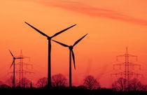 wind turbines in sunset by Janina Fremke