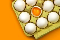 Broken Egg in egg carton by Peter Zvonar