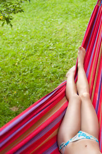 Girl's legs in a hammock  by Dmitry Malyshev