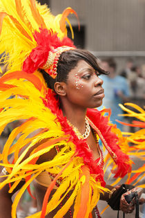 Colourful headgear at the Notting Hill Carnival. by Tom Hanslien