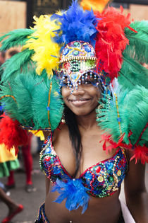 Very colourful feathery headgear at the Notting Hill Carnival. by Tom Hanslien