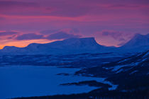 Sunrise behind the U-shaped mountain called Lapporten, Lapland, Sweden by kbhsphoto