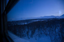 Train through Lapland in the north of Sweden at dusk by kbhsphoto