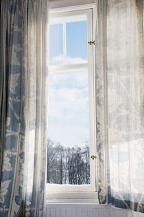 Window with bleached curtains von kbhsphoto