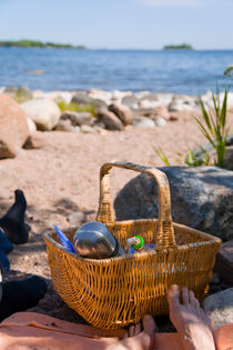 Picnic basket and feet on a  beach by kbhsphoto