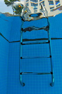 Ladder of swimming pool by Sami Sarkis Photography