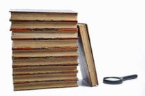 Ancient books and magnifying glass by Sami Sarkis Photography