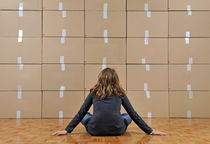 Girl seated in front of cardboard boxes von Sami Sarkis Photography