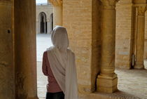 Wman wearing veil inside Kairouan Great Mosque by Sami Sarkis Photography