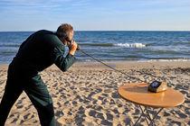 Businessman on beach with Landline Phone by Sami Sarkis Photography