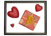 Gift box and heart-shaped objects in picture frame von Sami Sarkis Photography