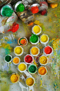 Bunch of opened paint tubes on palette by Sami Sarkis Photography