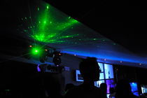People dancing and light effects in discotheque by Sami Sarkis Photography