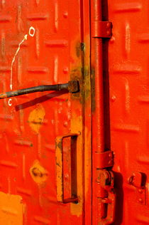 Container's red locked door at harbor by Sami Sarkis Photography