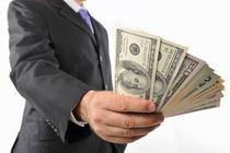 Man holding American Dollars in fan shape von Sami Sarkis Photography