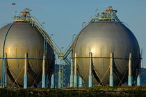 Oil tanks in petroleum refinery by Sami Sarkis Photography