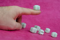 Polystyrene cube on man's finger von Sami Sarkis Photography