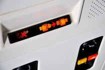 Fasten Seat belt and no smoking signs in airplane by Sami Sarkis Photography