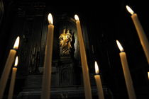 Virgin Mary with Infant by candles in church by Sami Sarkis Photography