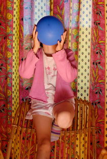 Girl blowing up balloon by Sami Sarkis Photography