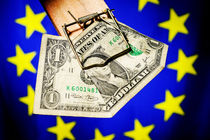 One dollar bill in mousetrap on European Union Flag von Sami Sarkis Photography