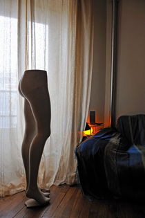 Mannequin legs by sofa in living room by Sami Sarkis Photography