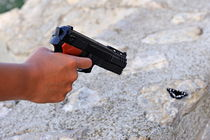 Woman pointing a toy gun on butterfly von Sami Sarkis Photography