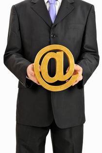Businessman holding At Symbol von Sami Sarkis Photography