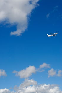 Commercial airplane in flight by Sami Sarkis Photography