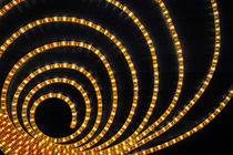 Light tube in spiral shape at wall by Sami Sarkis Photography
