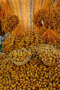 Fresh date fruits on market stall by Sami Sarkis Photography