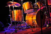 Drum kit illuminated on stage by Sami Sarkis Photography