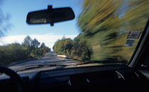 Speeding car on country road by Sami Sarkis Photography