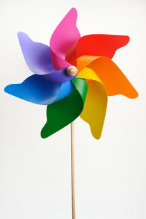 Colorful windmill on white background by Sami Sarkis Photography