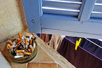 Cigarette butts in ashtray by Sami Sarkis Photography
