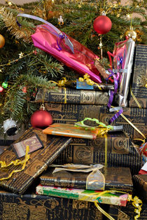 Gift wrapped presents under Christmas tree by Sami Sarkis Photography