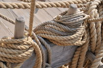 Ropes on wooden sailboat upper deck by Sami Sarkis Photography