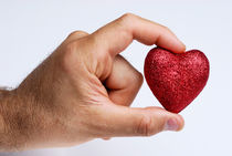 Man holding glittery heart by Sami Sarkis Photography
