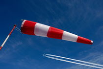 Windsock and airplane against sky von Sami Sarkis Photography