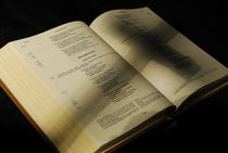 Crucifix shadow on French Holy Bible von Sami Sarkis Photography