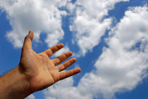 Mans hand reaching for clouds by Sami Sarkis Photography